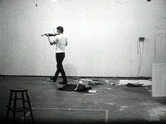 nauman playing note on violin